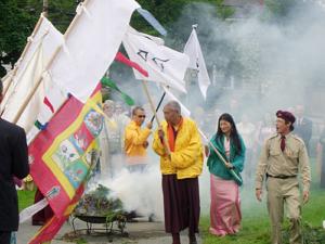 Sakyong Mipham Rinpoche, Namkha Drimed Rinpoche, and Khandro Tseyang perform lhasang at the Kalapa Festival assisted by Mark. Photo by Peter Roberts.