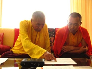 Namkha Drimed Rinpoche and Sakyong Mipham Rinpoche look at the Sakyong's new longevity chant.