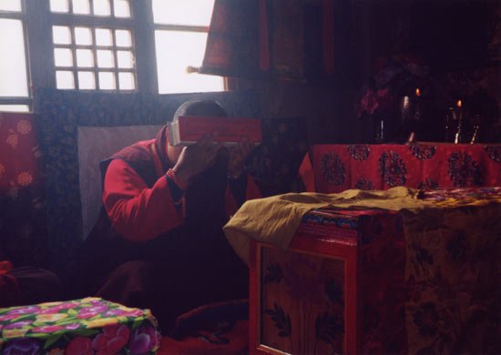 Sakyong Mipahm Rinpoche receives the Collected Tibetan Works of his father, the Vidyadhara, from Karma Senge Rinpoche while visiting Dorje Khyung Dzong in Surmang, Tibet. Photo by Diana Church.